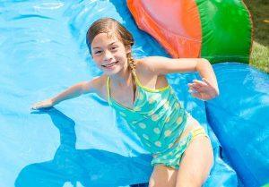 Girl Smiling In Slide